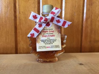 Voisin's pure Canadian maple syrup in a decorative glass maple leaf bottle with a maple leaf ribbon