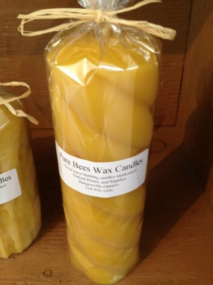 Oxford pure beeswax spiral pillar candle wrapped in cellophane