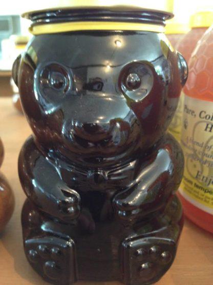 Buckwheat honey in a glass bear jar