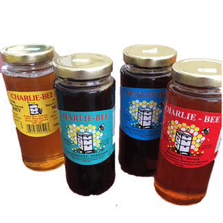 4 jars of various flavours of Charlie-Bee honey