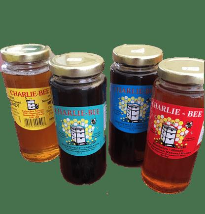 4 jars of various flavours of Charlie-Bee honey