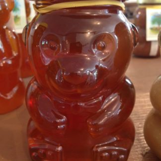 Honey in a glass bear bottle