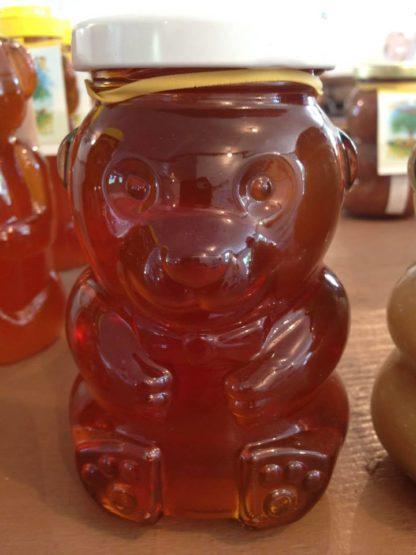 Honey in a glass bear bottle