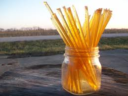 A jar of honey summerblossom sticks sitting outside