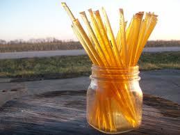 A jar of honey summerblossom sticks sitting outside