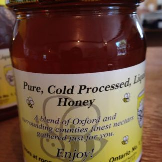 Pure, cold processed, liquid honey in a glass jar