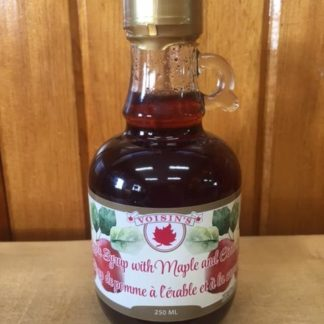 Bottle of Voisin's apple syrup with maple and cinnamon
